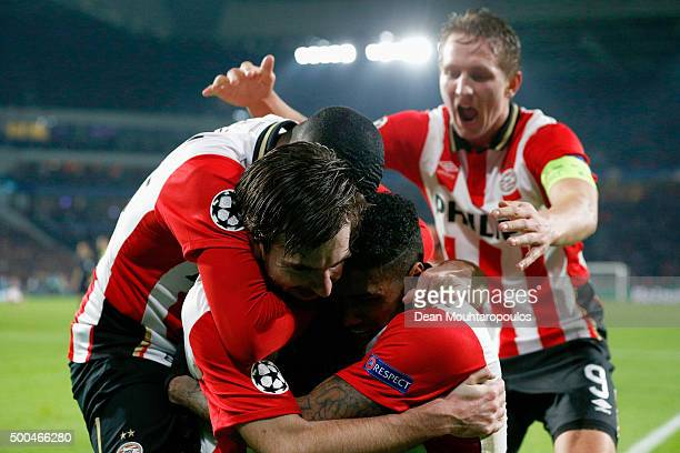 Davy Propper of PSV celebrates scoring his teams second goal of the game with teammates during the group B UEFA Champions League match between PSV...