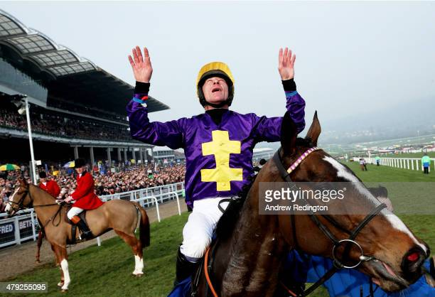 Davy Russell celebrates after riding Lord Windermere to victory in the Betfred Cheltenham Gold Cup Chase on Gold Cup day at the Cheltenham Festival...