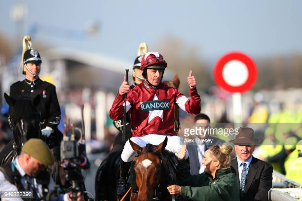 Davy Russell celebrates after riding Tiger Roll to victory during the 2018 Randox Health Grand National at Aintree Racecourse on April 14 2018 in...