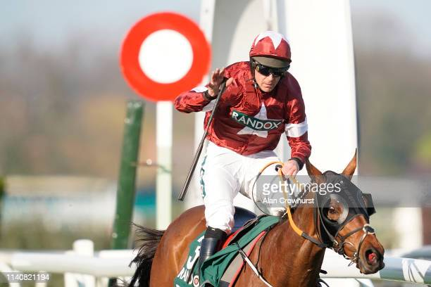 Davy Russell celebrates as he rides Tiger Roll to win The Randox Health Grand National on Grand National Day at Aintree Racecourse on April 06, 2019...