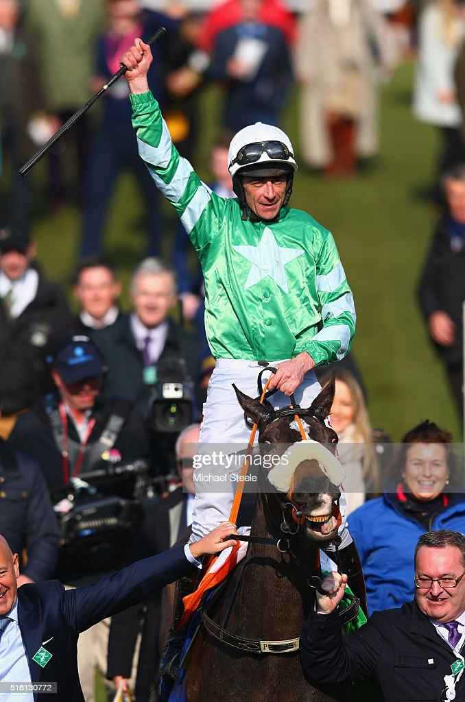 Davy Russell celebrates riding Mall Dini to victory in the Pertemps Network Final on day three, St Patrick's Thursday, of the Cheltenham Festival at Cheltenham Racecourse on March 17, 2016 in Cheltenham, England.