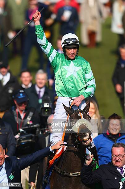 Davy Russell celebrates riding Mall Dini to victory in the Pertemps Network Final on day three St Patrick's Thursday of the Cheltenham Festival at...