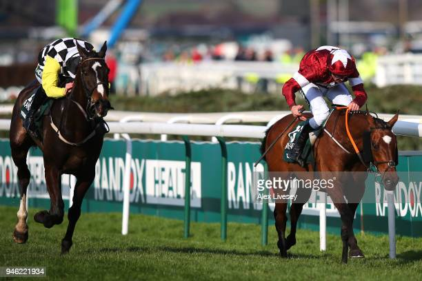 Davy Russell rides Tiger Roll to victory closely followed by David Mullins riding Pleasant Company during the 2018 Randox Health Grand National at...