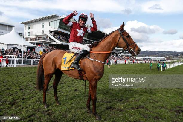 Davy Russell riding Blako des Flos win The Ryanair Steeple Chase at Cheltenham racecourse on St Patrick's Thursday on March 15 2018 in Cheltenham...