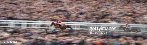 Davy Russell riding Envoi Allen clear the last to win The Ballymore Novices' Hurdle on Ladies Day at Cheltenham Racecourse on March 11 2020 in...