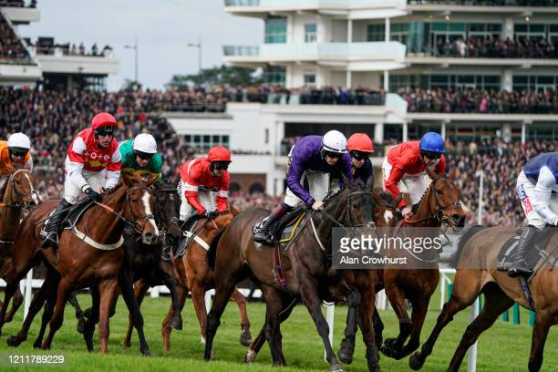 Davy Russell riding Envoi Allen on their way to winning The Ballymore Novices' Hurdle on Ladies Day at Cheltenham Racecourse on March 11 2020 in...