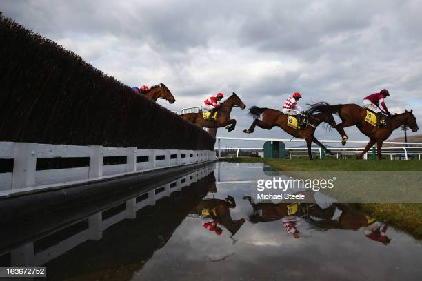 Davy Russell riding First Lieutenant leads the field over the water jump during the Ryanair Steeple Chase race on St Patrick's Thursday at Cheltenham...