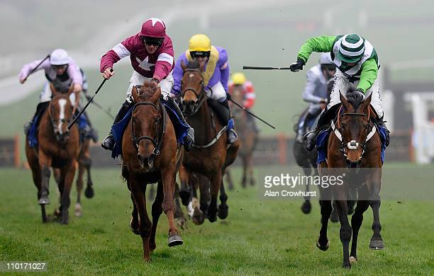 Davy Russell riding First Lieutenant win The Neptune Investment Management Novices' Hurdle from Rock On Ruby during the Cheltemham Festival Ladies...