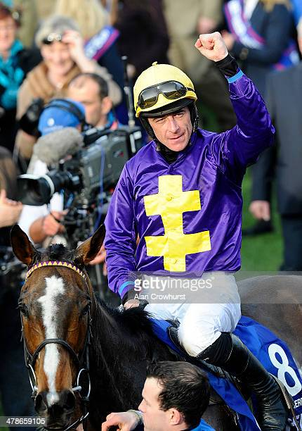 Davy Russell riding Lord Windermere celebrates winning The Betfred Cheltenham Gold Cup Steeple Chase during Cheltenham Gold Cup day at the Cheltenham...