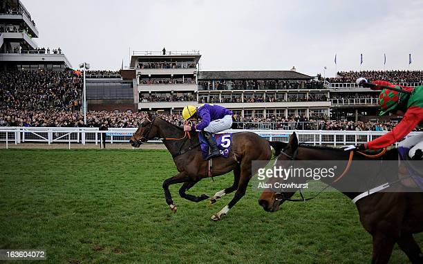 Davy Russell riding Lord Windermere clear the last to win The RSA Steeple Chase from Lyreen Legend during Ladies Day at Cheltenham racecourse on...