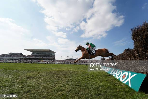 Davy Russell riding Ornua on their way to winning The Doom Bar Maghull Novices' Chase on Grand National Day at Aintree Racecourse on April 06, 2019...