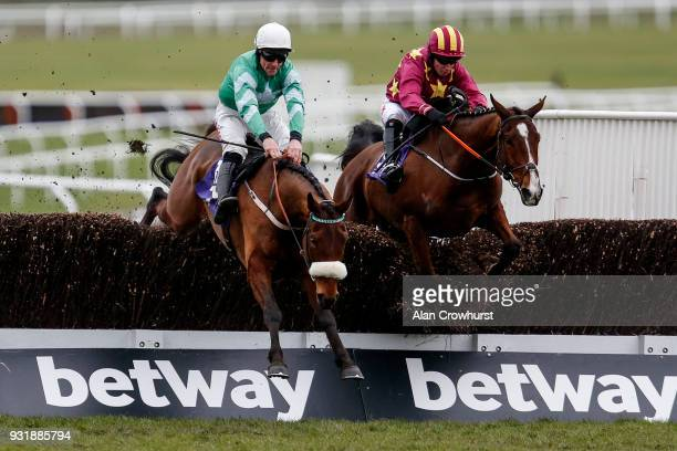 Davy Russell riding Presenting Percy clear the second last before winning The RSA Insurance Novices' Steeple Chase at Cheltenham racecourse on Ladies...