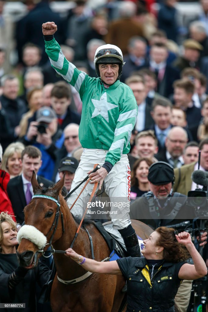 Davy Russell riding Presenting Percy win The RSA Insurance Novices' Steeple Chase at Cheltenham racecourse on Ladies Day on March 14, 2018 in Cheltenham, England.