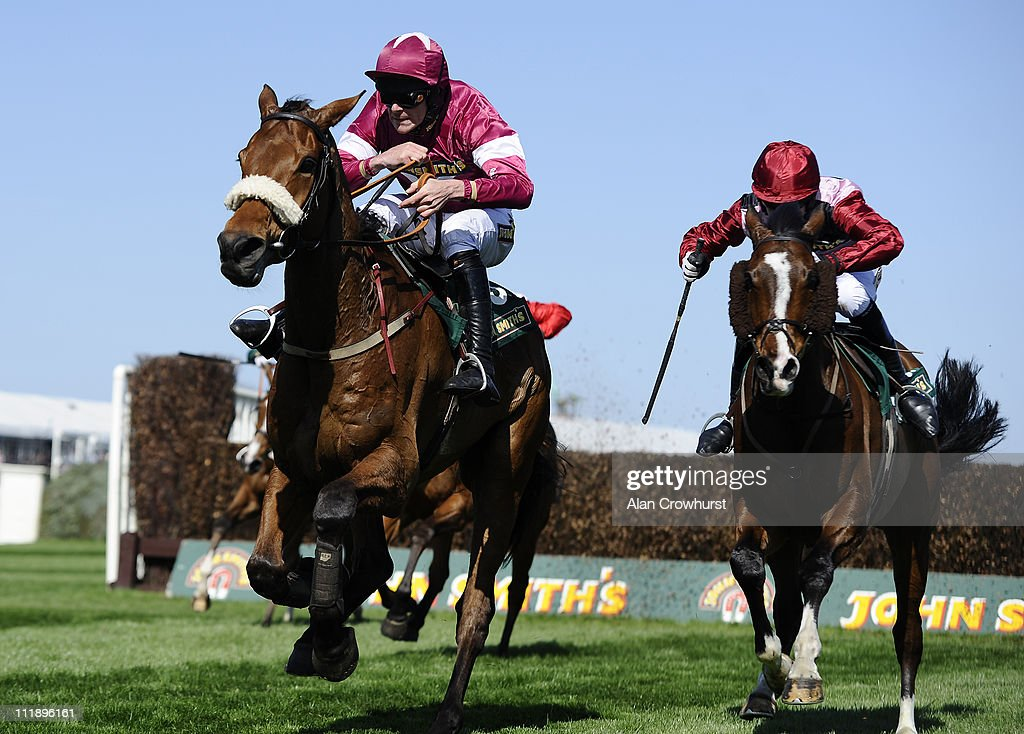 Davy Russell riding Quito De La Roque (L) clear the last to win The John Smith's Mildmay Novices' Steeple Chase from Sarando (R) on Ladies Day at Aintree racecourse on April 08, 2011 in Liverpool, England .