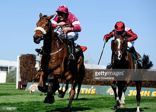 Davy Russell riding Quito De La Roque clear the last to win The John Smith's Mildmay Novices' Steeple Chase from Sarando on Ladies Day at Aintree...