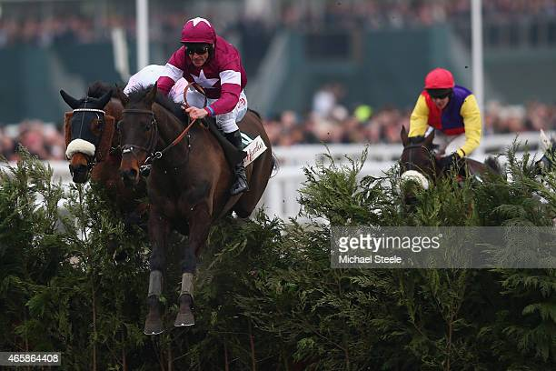 Davy Russell riding Rivage D'Or clears the last to win the Glenfarclas Handicap Steeple Chase during day two of the Cheltenham Festival at Cheltenham...