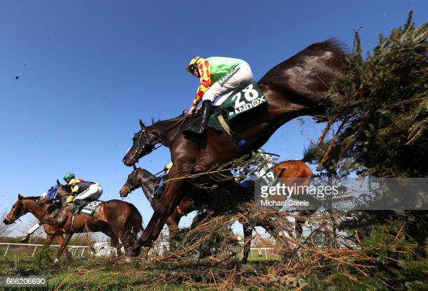 Davy Russell riding Saint Are jumps over the canal during the 2017 Randox Heath Grand National at Aintree Racecourse on April 8 2017 in Liverpool...
