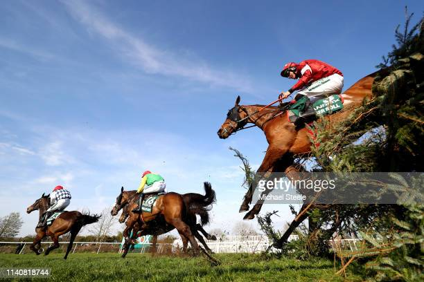 Davy Russell riding Tiger Roll clears the Canal Turn during the Randox Health Grand National Handicap Chase at Aintree Racecourse on April 06, 2019...