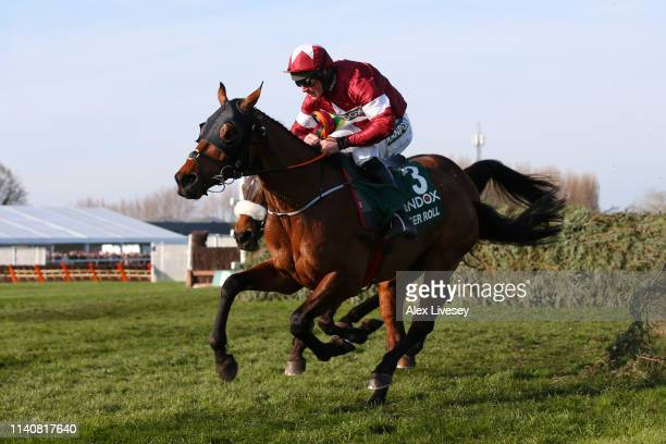 Davy Russell riding Tiger Roll races to victory during the Randox Health Grand National Handicap Chase at Aintree Racecourse on April 06, 2019 in...