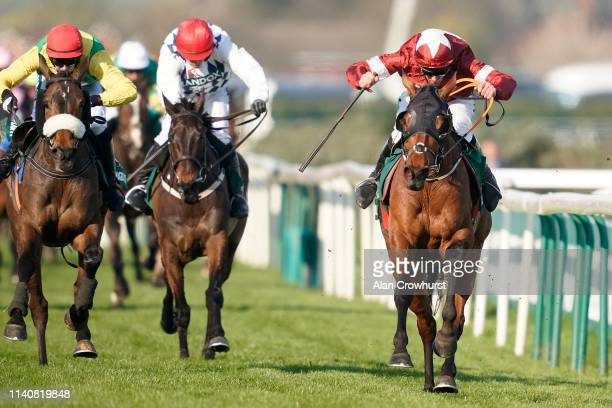 Davy Russell riding Tiger Roll win The Randox Health Grand National from Magic Of Light and Rathvinden on Grand National Day at Aintree Racecourse on...
