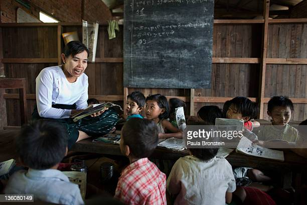 Daw Aye Aye teaches a class at a small government run school December 14 2011 in Waw township Myanmar The education system is based on the United...
