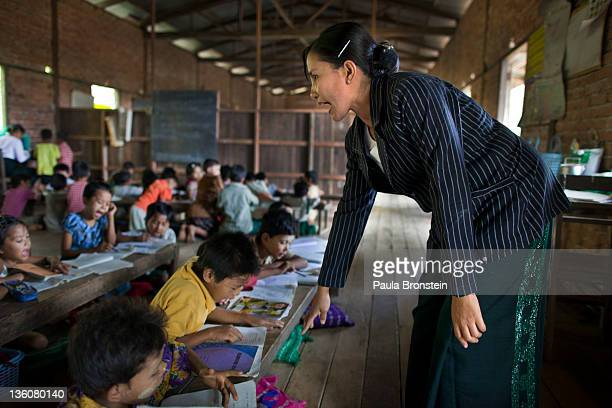 Daw Khin Markyu teaches a class at a small government run school December 14 2011 in Waw township Myanmar The education system is based on the United...