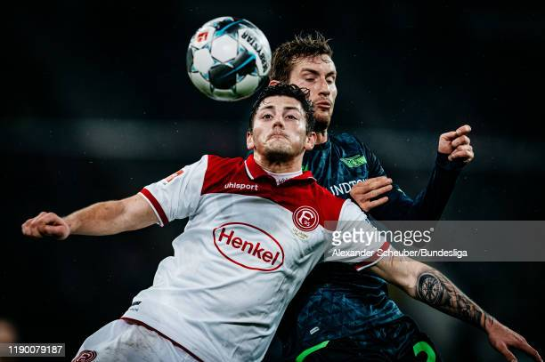 Dawid Kownacki of Duesseldorf in action against Christopher Lenz of Union Berlin during the Bundesliga match between Fortuna Duesseldorf and 1. FC...