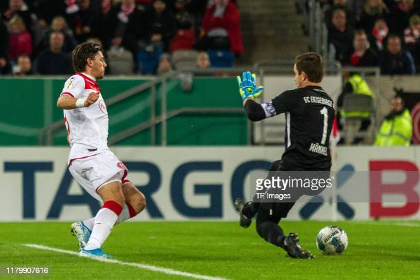 Dawid Kownacki of Fortuna Duesseldorf and Martin Maennel of Erzgebirge Aue battle for the ball during the DFB Cup second round match between Fortuna...