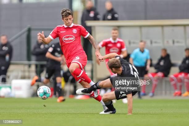 Dawid Kownacki of Fortuna Duesseldorf and Tony Jantschke of Borussia Moenchengladbach battle for the ball during the test match between Borussia...