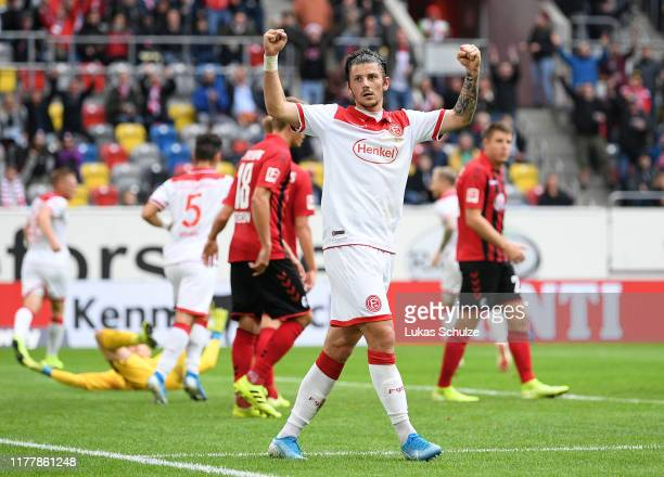 Dawid Kownacki of Fortuna Dusseldorf celebrates his teams first goal during the Bundesliga match between Fortuna Duesseldorf and Sport-Club Freiburg...