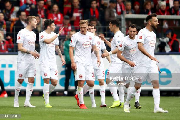 Dawid Kownacki of Fortuna Dusseldorf celebrates scoring his sides first goal with his team during the Bundesliga match between Sport-Club Freiburg...