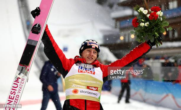 Dawid Kubacki of Poland celebrates after he wins the gold medal in the ski jumping Men's HS109 final round during the 2019 FIS World Ski...