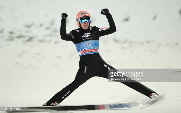 Dawid Kubacki of Poland celebrates winning after his second jump during the 68th FIS Nordic World Cup Four Hills Tournament at...