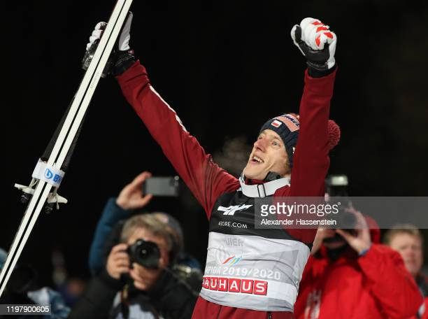 Dawid Kubacki of Poland celebrates winning after the 68th FIS Nordic World Cup Four Hills Tournament at Paul-Ausserleitner-Schanze on January 06,...