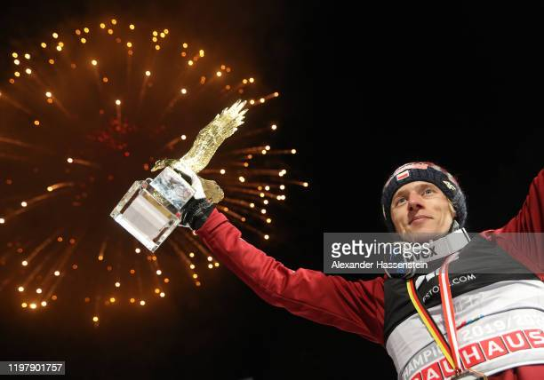Dawid Kubacki of Poland celebrates winning with the golden eagle trophy after the 68th FIS Nordic World Cup Four Hills Tournament at...