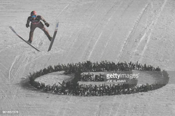 Dawid Kubacki of Poland competes during the fourth and final stage of the FourHills Ski Jumping tournament in Bischofshofen Austria January 6 2018 /...