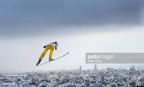 Dawid Kubacki of Poland flies over Sapporo during day two of the FIS Men's Ski Jumping World Cup at Okurayama Jump Stadium on January 20, 2013 in...