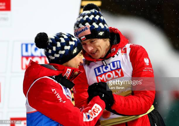 Dawid Kubacki of Poland, gold medal and Kamil Stoch of Poland, silver medal celebrate after in the ski jumping Men's HS109 final round during the...