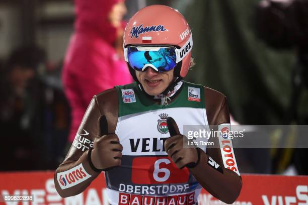 Dawid Kubacki of Poland reacts after he competes in the FIS Nordic World Cup on day 2 of the Four Hills Tournament ski jumping event on December 30...