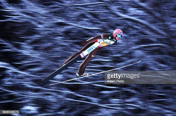 Dawid Kubacki of Poland soars through the air during his first competition jump of the Flying Hill Team competition of the Ski Flying World...