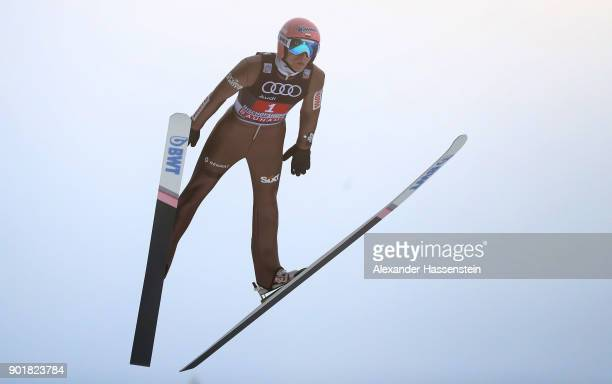 Dawid Kubacki of Poland soars through the air during his practice jump of the FIS Nordic World Cup Four Hills Tournament on January 6 2018 in...
