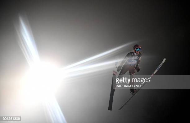 Dawid Kubacki of Poland soars through the air during the qualification for the fourth and final stage of the FourHills Ski Jumping tournament in...