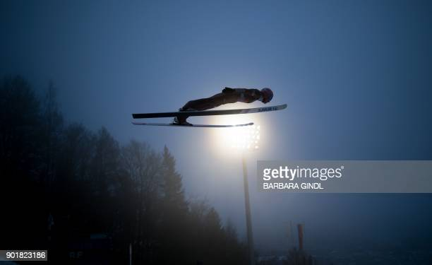 Dawid Kubacki of Poland soars through the air during the trial jump at the fourth and final stage of the FourHills Ski Jumping tournament in...
