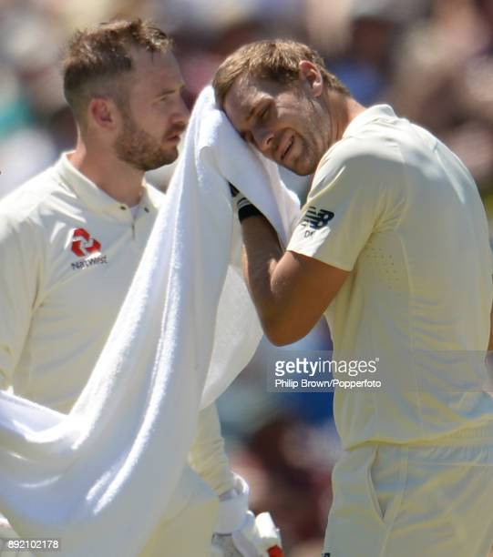 Dawid Malan and Mark Stoneman of England wait for the result of a review during the first day of the third Ashes cricket test match between Australia...