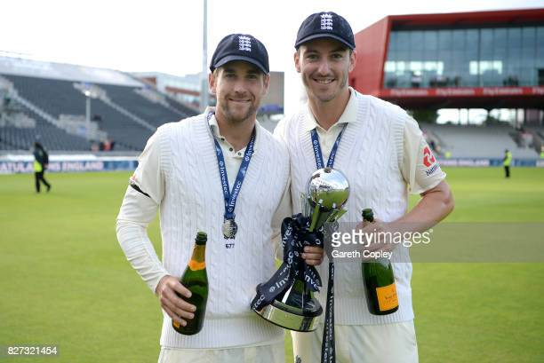 Dawid Malan and Toby Roland Jones of England celebrate with the series trophy after winning the Investec Test series between England and South Africa...