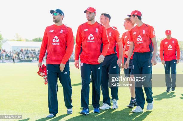 Dawid Malan James Vince Lewis Gregory Jonny Bairstow and Pat Brown of England walk from the ground after their win in game one of the Twenty20...