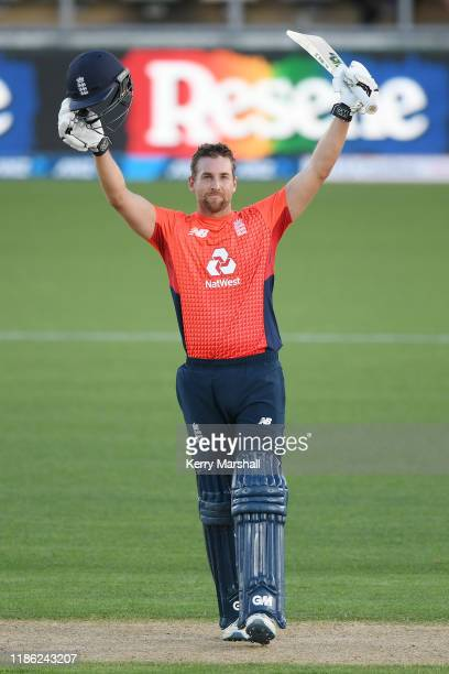 Dawid Malan of England celebrates 100 runs during game four of the Twenty20 International series between New Zealand and England at McLean Park on...