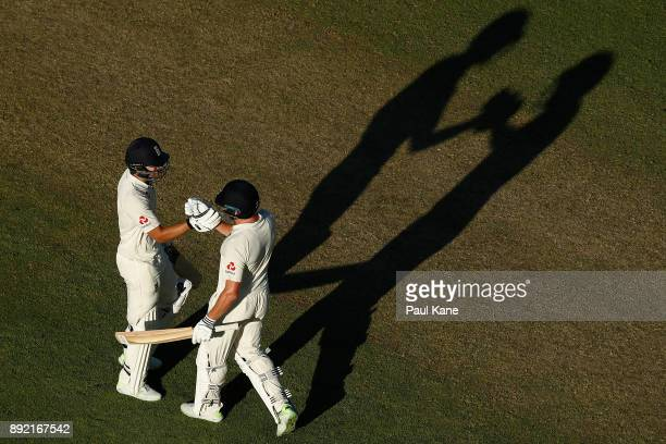 Dawid Malan of England celebrates his century with Jonny Bairstow of England during day one of the Third Test match of the 2017/18 Ashes Series...