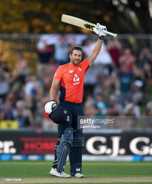 Dawid Malan of England celebrates reaching his century during game four of the Twenty20 International series between New Zealand and England at...