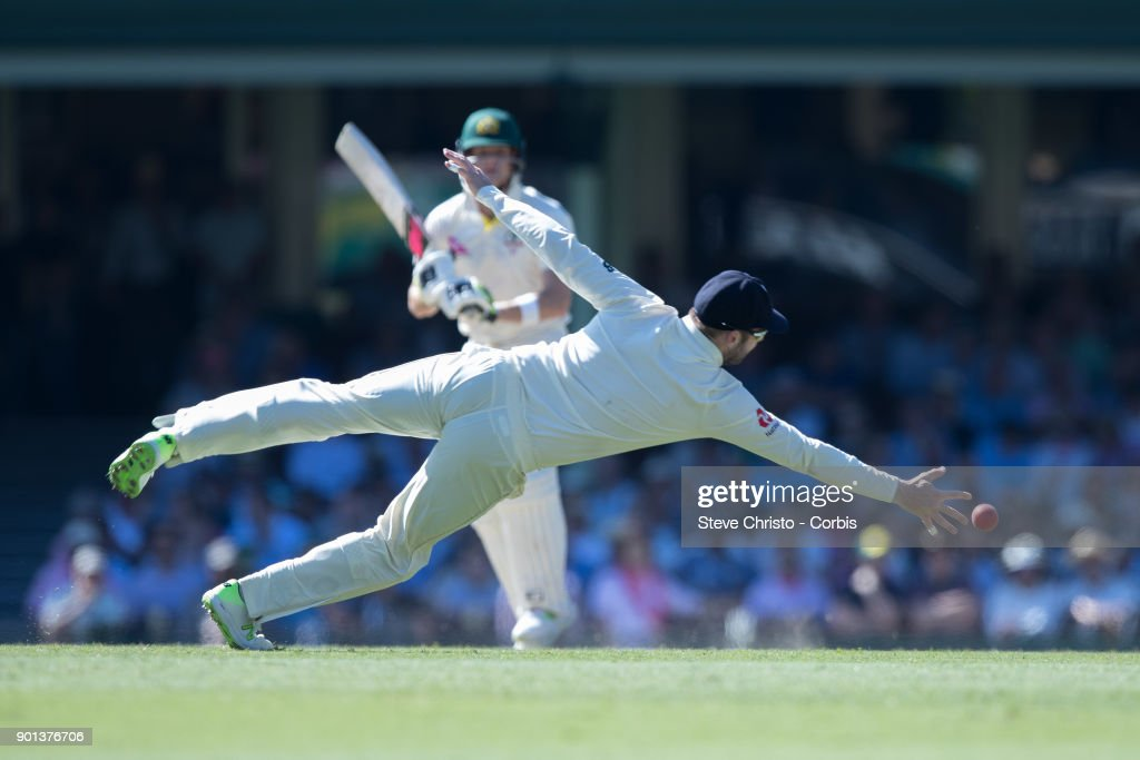 Dawid Malan of England dives to stop runs from Australia's Steve Smith during day two of the Fifth Test match in the 2017/18 Ashes Series between Australia and England at Sydney Cricket Ground on January 5, 2018 in Sydney, Australia.